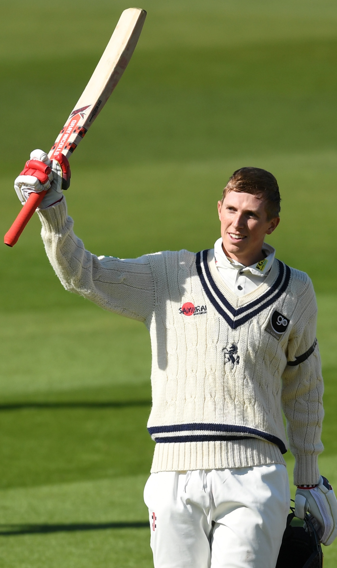 Zak Crawley of Kent celebrates reaching his century during the Specsavers County Championship match between Warwickshire and Kent at Edgbaston Cricket Ground on April 11, 2019 (Photo by Gareth Copley/Getty Images).