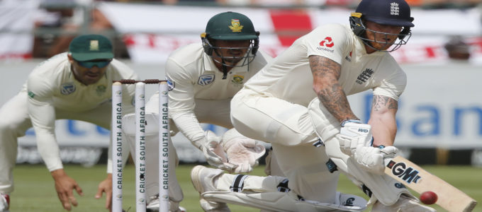 Ben Stokes (R) plays a shot vs South Africa during the fourth day of the second Test cricket match between South Africa and England at the Newlands stadium in Cape Town on January 6, 2020.